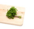 parsley on wooden board