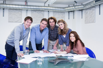 Confident creative professionals in conference room