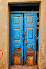 worn down blue door