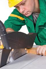 Carpenter working on an circular saw....