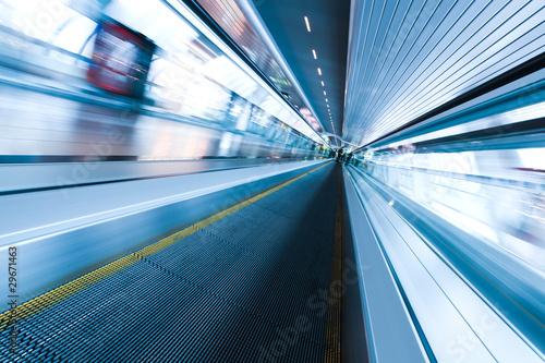 diminishing moving escalator in office center - 29671463