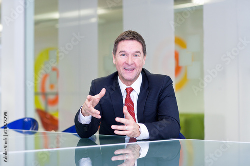 Businessman talking at conference table