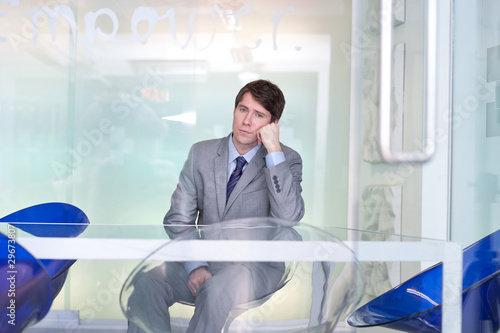 Concerned businessman in conference room