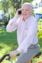 Active old man on phone