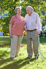 Mature couple walking in the yard