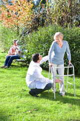 Helping elder woman to walk