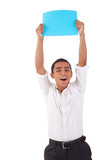 happy young latino man, raised arms with blue card in hand