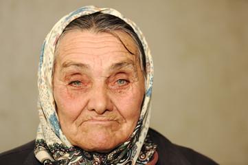 Closeup portrait of elderly serious woman