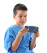 Cute boy playing with playstation isolated on white background.