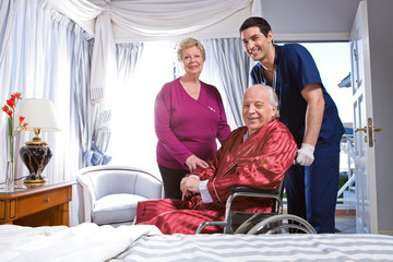 Elder couple with an assistant in a hospital