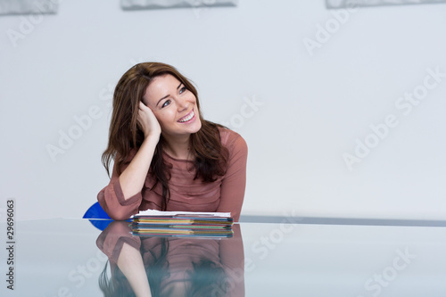 Smiling woman in conference room