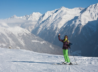 The woman and winter mountain. Solden,  Austria