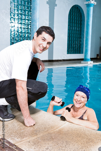Young trainer consulting elder woman
