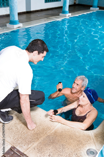Young trainer with elder people