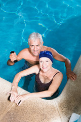 Elder couple in a swimming pool