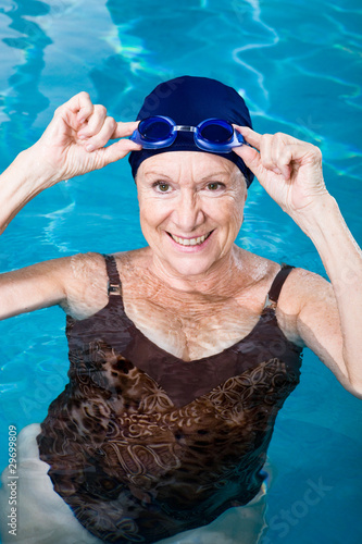 Woman trying on swimming glasses