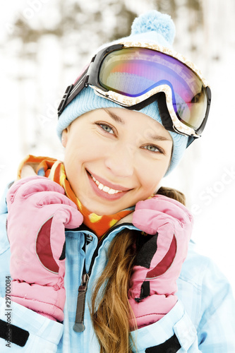 Portrait of a happy young female skier