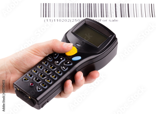 Electronic manual scanner of bar codes in woman hand