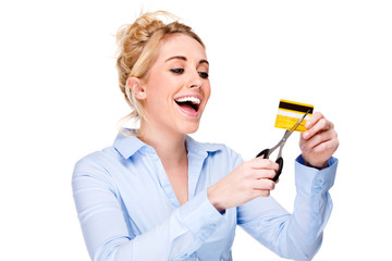 Debt Free - Attractive woman cutting up her credit card