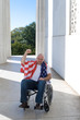 Man Wheelchair American Flag Raised Fist Blue Sky