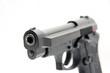 pointing gun closeup in white background
