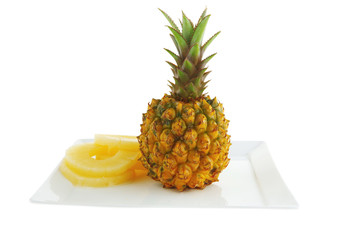 fresh raw pineapple and slices