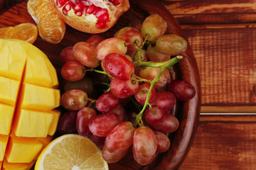 fruits on wooden plate