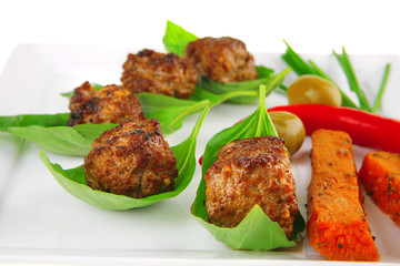 grilled cutlets on basil leafs