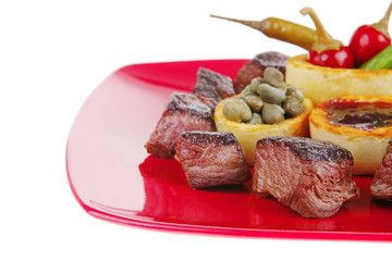 food: roast beef meat over red plate