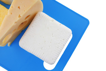 cheeses on blue plate