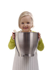 little girl with apron and big stainless steel bowl