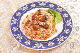 Uzbek national dish - plov on the plate