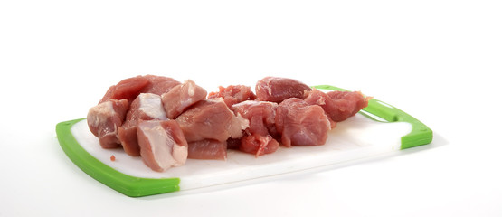 Fresh meat on a cutting board on a white background