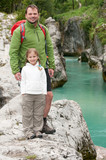 Little girl with father on mountain trek poster