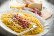 carbonara on dish with ingredients