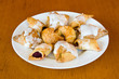Plate of assorted pastry on wooden table