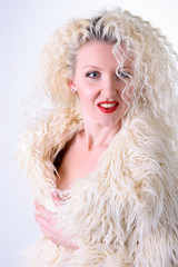 Curly blonde in a white fluffy fur coat