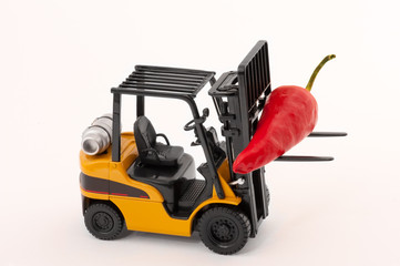 Toy fork lift with red pepper