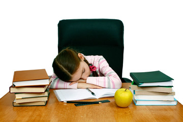 girl is asleep at the writing table with books