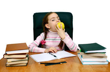 girl with an apple being at a writing table with books
