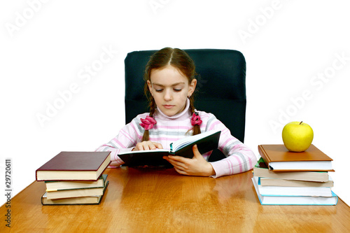 girl which reads a book at the writing table