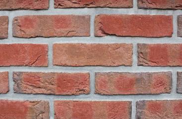 Backsteinmauer, rot