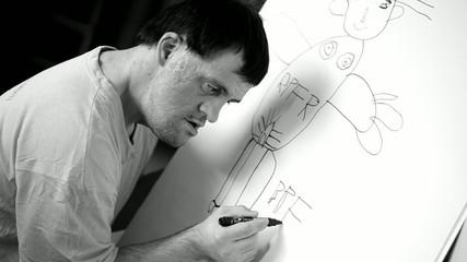 homme trisomique dessinant
