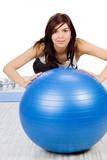 Woman making exercise with fitness ball