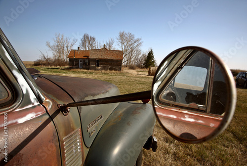 Antique Chevy farm truck in old farmyard