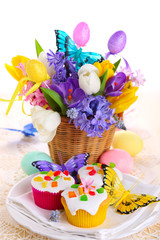 Easter arrangement of hyacinths and tulips cupcakes with eggs