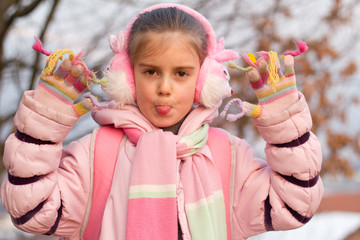 Winter happiness, adorable little girl with winter clothes
