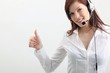 young woman with headset and thumb up