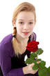 Leinwanddruck Bild - young girl posing with red rose over white background