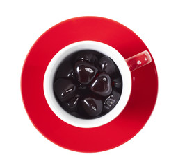 red cup on the saucer